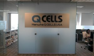 hanwha-q-cells-rebrands-and-adds-glass-like-lobby-sign-in-irvine1