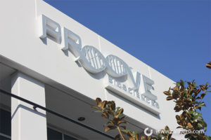 Proove Building Sign by Day