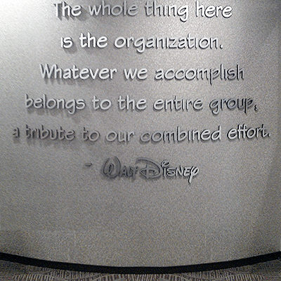 Disney brushed silver lettering on lobby wall Orange County - Caliber Signs & Imaging in Irvine Call: 949-748-1070