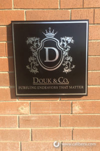 Douk & Co. Custom Exterior Plaque Orange County - Caliber Signs & Imaging in Irvine Call: 949-748-1070