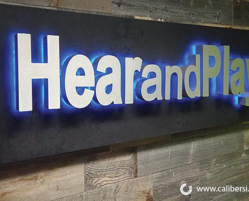 HearAndPlay Custom illuminated brushed silver lobby sign Orange County - Caliber Signs & Imaging in Irvine Call: 949-748-1070