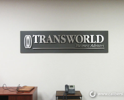 Transworld Brushed Silver Lobby with Acrylic Backer Orange County - Caliber Signs & Imaging in Irvine Call: 949-748-1070