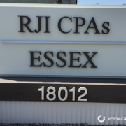 RJI and ESSEX monument sign - Orange County by Caliber Signs & Imaging in Irvine - 949-748-1070