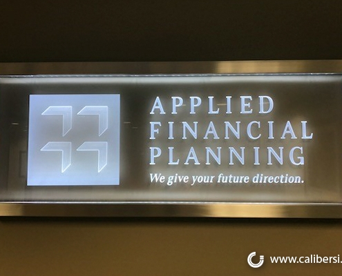 Applied Financial Planning office sign in Irvine, CA.