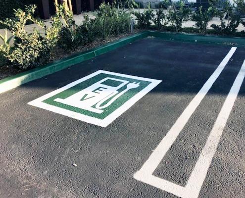 EV Parking Sign on Asphalt Irvine CA Caliber Signs and Imaging WEB