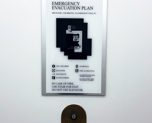 Emergency Evacuation Sign Caliber Signs and Imaging WEB