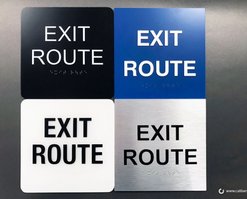 Family of ADA Code Exit Signs in various colors Irvine CA Caliber Signs and Imaging WEB