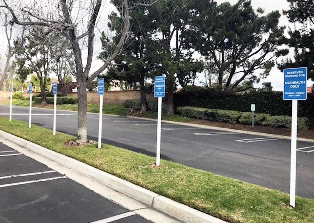 Reserved parking lot signs in Costa Mesa CA