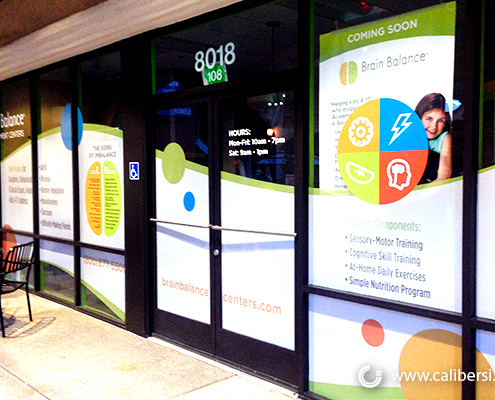 Outdoor Store Window Graphics Perforated Vinyl Brain Balance Caliber Signs and Imaging