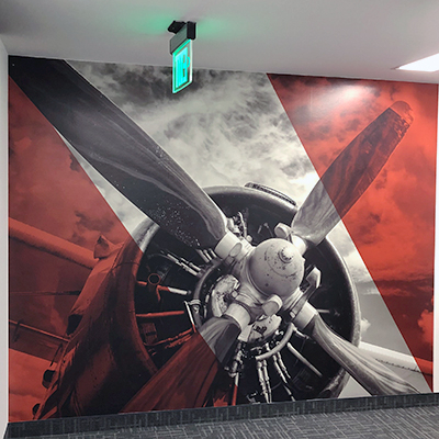 Wall Wrap on Corridor Custom Wall Sign Propellor Image Koll Caliber Signs and Imaging