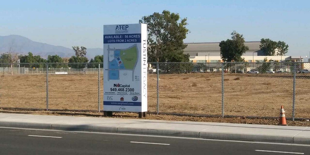 Commercial Real Estate For Lease Sign in Tustin CA