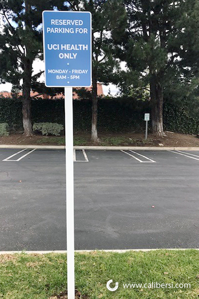 Company specific reserved parking signs in Irvine CA